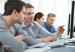 students attending training course in a computer classroom